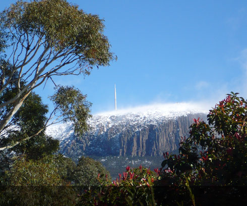 A little light snow covers the summit of Mt Wellington